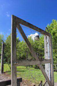 Gate separating the barrack area from the crematorium.